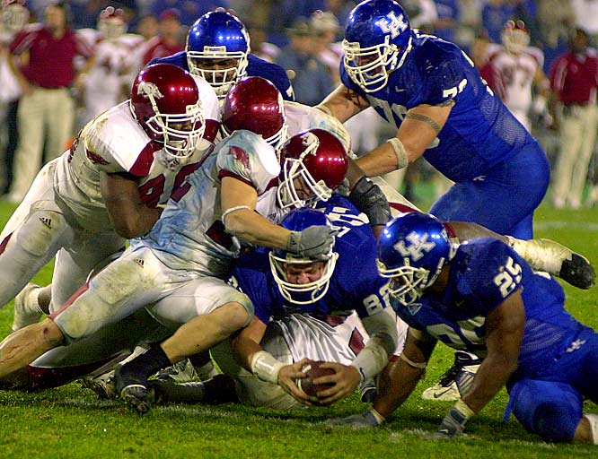 The longest NCAA football game ever played, the Razorbacks seemed to be on their way to a relatively easy win most of the afternoon. But Wildcats quarterback Jared Lorenzen brought his team back from a 21-7 halftime deficit and threw the tying touchown late in the fourth-quarter. Finally in the seventh overtime, Lorenzen lost grip of the football on a quarterback keeper and the Razorbacks took a 71-63 win.