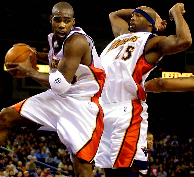 The Warriors were anything but golden during their run of 12 straight losing seasons without making the playoffs. They also subjected their fans to a streak of nine seasons (1977-86) without postseason action. Pictured are Antawn Jamison (1998-03 Warriors) and Erick Dampier (1997-04 Warriors).