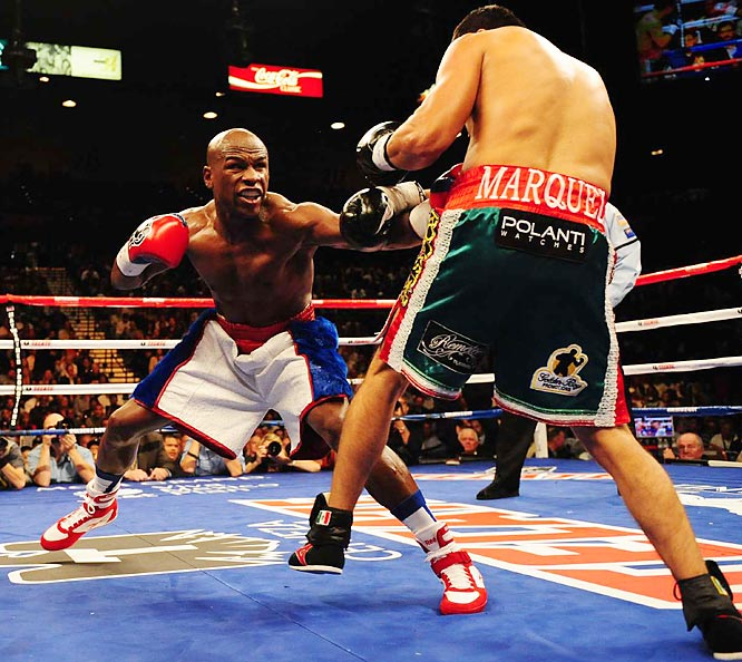 The size disparity was obvious from the start, but Marquez stayed on his feet for the full 12 rounds.