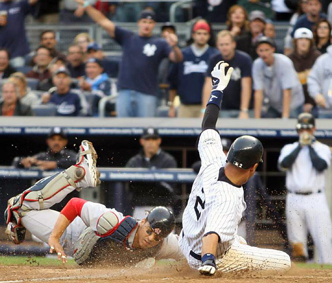 Victor Martinez, left, forced out Derek Jeter at home plate in the fifth inning. Jeter was trying to score from third base on teammate Alex Rodriguez's ground ball.