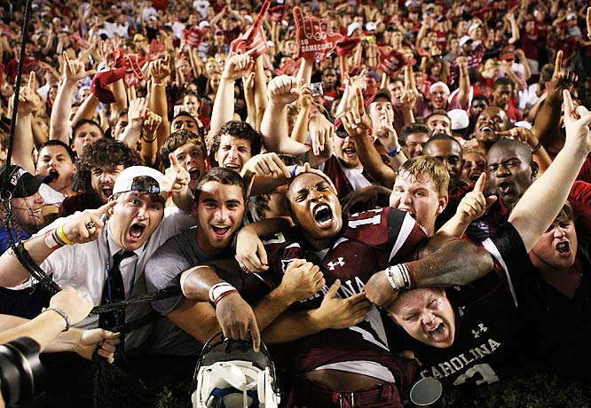 Chris Culliver #17 of the South Carolina Gamecocks celebrates with fans after a 16-10 victory over the Ole Miss Rebels after their game at Williams-Brice Stadium on September 24, 2009 in Columbia, South Carolina.