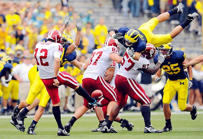 Jon Conover of the University of Michigan Wolverines nearly blocks a punt from Chris Hagerup (12) of the Indiana University Hoosiers during the Wolverines 36-33 victory over the Hoosiers at Michigan Stadium in Ann Arbor, MI.