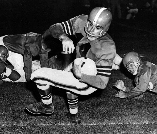 """In Peter King's upcoming book, Monday Morning Quarterback, he writes, """"If I'm building a team for a three- or five-year window, whom would I choose?"""" Here are the top 12 quarterbacks from his list and his skinny on each, beginning with Otto Graham. """"He won seven league titles and seven passing titles in a legendary 10-year career."""""""