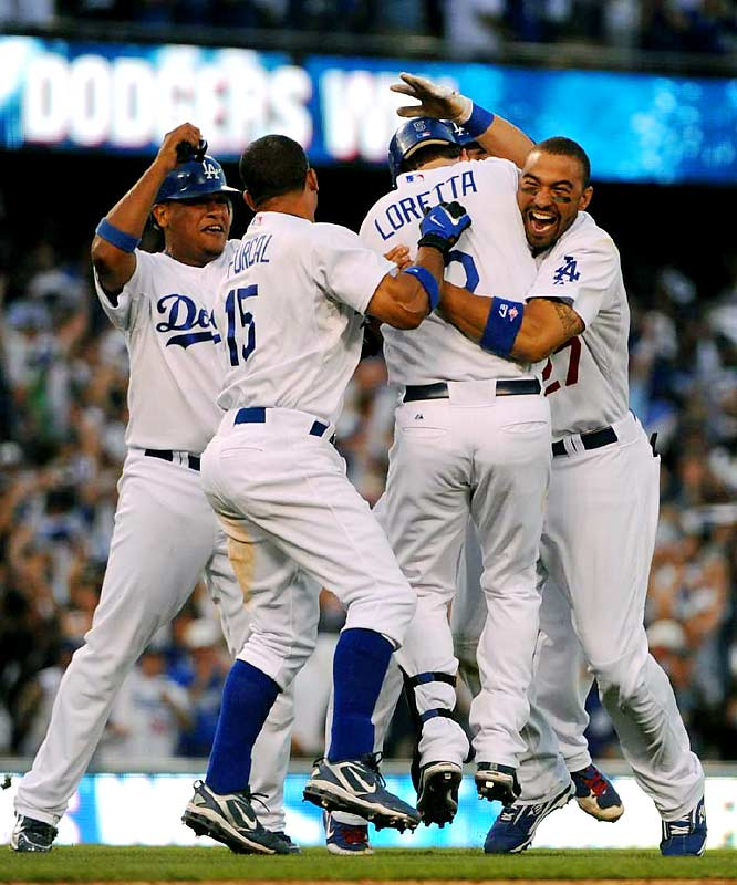 Dodgers players celebrate with Mark Loretta after his walk-off RBI single.