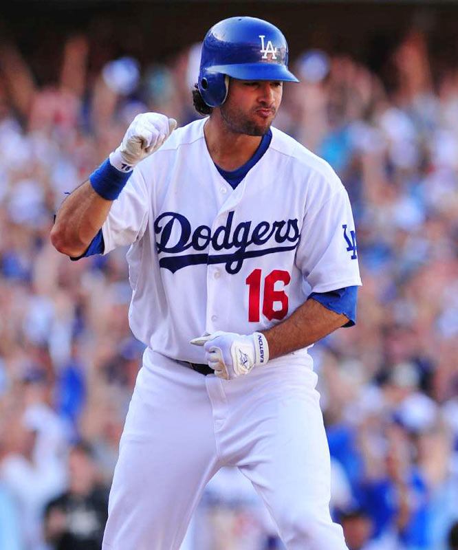 Andre Ethier celebrates after being walked with the bases loaded, driving in the winning run in the eighth inning.