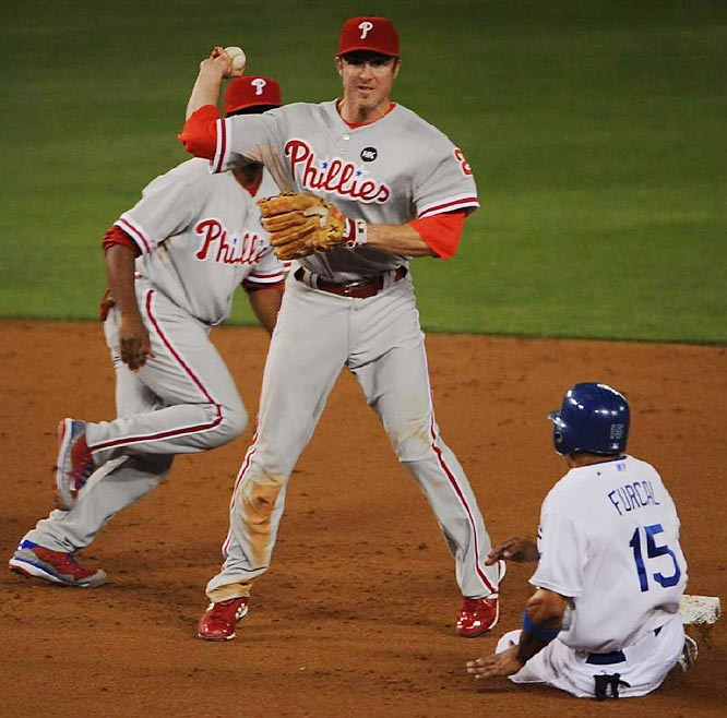 Second basemen Chase Utley throws the ball away on a double play attempt, allowing Russell Martin of the Dodgers (not pictured) to score in the fifth inning.
