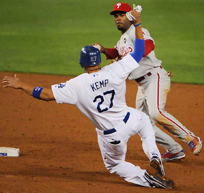 Shortstop Jimmy Rollins turns a double play over Matt Kemp in the ninth.
