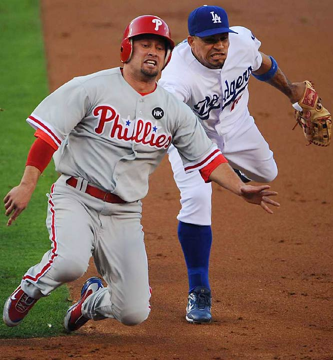 Rafael Furcal tags out Shane Victorino in the first inning. Victorino was caught in a rundown while trying to steal.