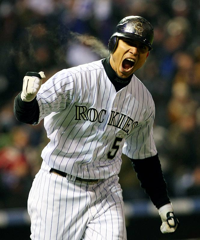 Carlos Gonzalez reacts after hitting a home run in the bottom of the fourth