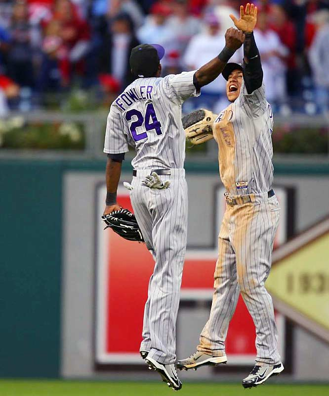 Outfielders Dexter Fowler and Carlos Gonzalezcelebrate the Rockies' victory.