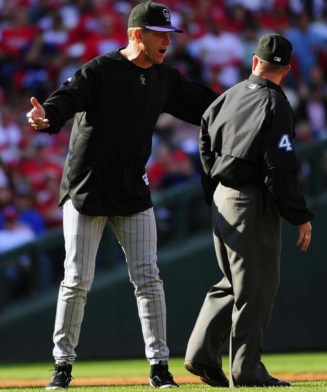 Rockies manager Jim Tracy protests a call with second-base umpire Jerry Meals in the third inning.