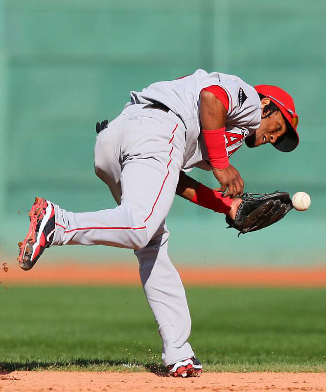 Shortstop Erick Aybar could only knock down this ground ball.