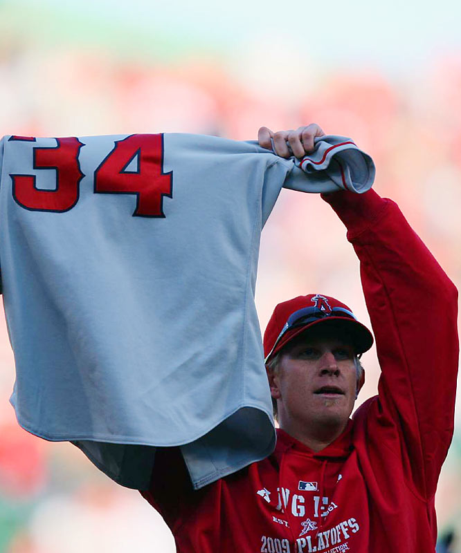 Jered Weaver holds Nick Adenhart's jersey while celebrating the Angels' sweep of the Red Sox.