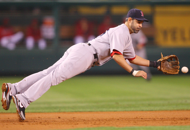Mike Lowell makes a diving stop at the hot corner.