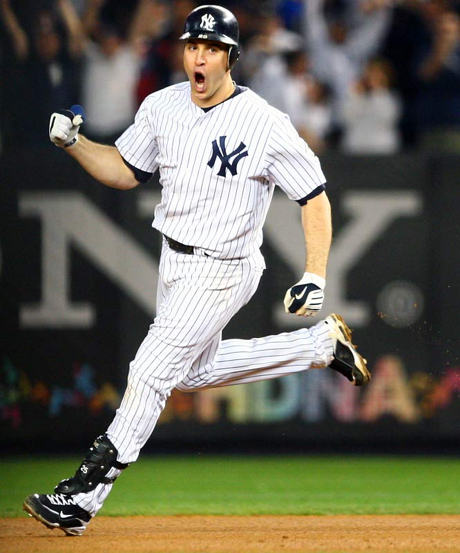 Mark Teixeira celebrates his walk-off home run in the 11th.