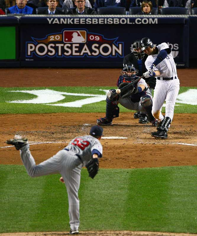 Derek Jeter hits a two-run homer off Brian Duensing in the third inning.