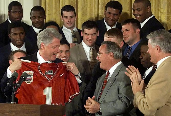 President Clinton shares a laugh with the Florida State coach during a ceremony honoring the national champions at the White House.