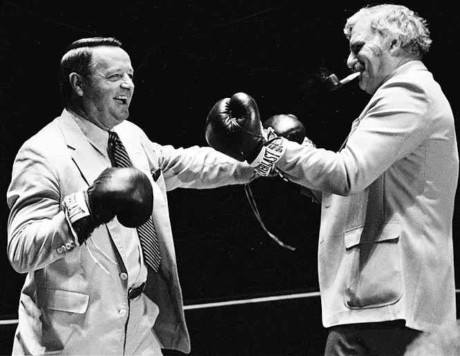 Bobby Bowden throws a punch at Miami coach Howard Schnellenberger during a mock boxing match prior to their squads meeting in Tallahassee.