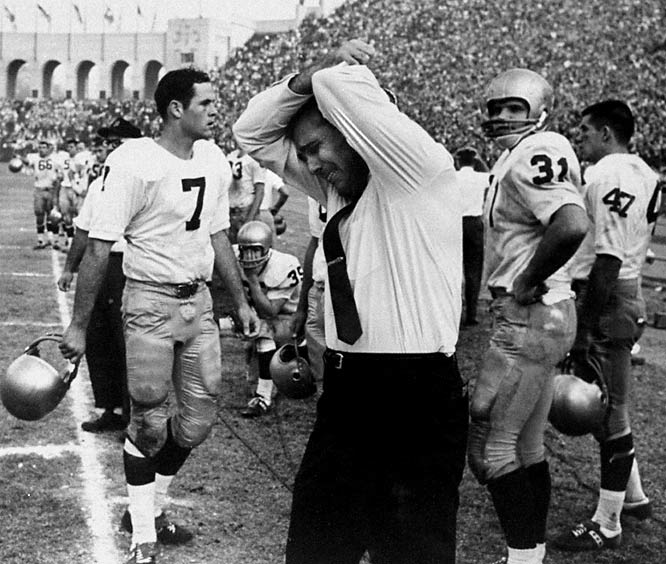 After five consecutive .500 or below seasons under Joe Kuharich, first-year Irish coach Ara Parseghian takes the Irish from unranked at the start of the season to 9-0 and No. 1 entering the Coliseum. The Irish lead 17-13 and USC faces fourth down on the Irish 15 with 1:33 remaining. Then Trojan quarterback Craig Fertig finds Rod Sherman in the end zone for the game-winner, spoiling Parseghian's bid for a national title.