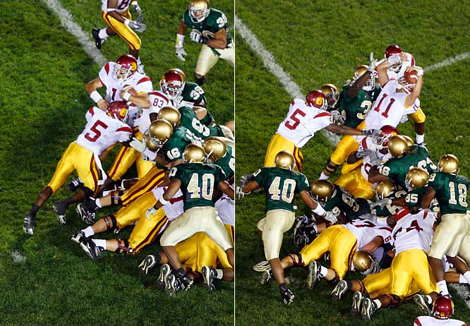 USC's 27-game winning streak was in jeopardy when Matt Leinart's last-second, goal line fumble appeared to give the Fighting Irish a victory. Notre Dame fans stormed the field but the ref granted USC one final play from the two-yard line. Leinart took the snap and tried to sneak into the endzone but was met by a large group of Irish defenders. Seeing Leinart stood up at the goal line and needing forward momentum, Reggie Bush pushed Leinart into the endzone to give the Trojans the victory.
