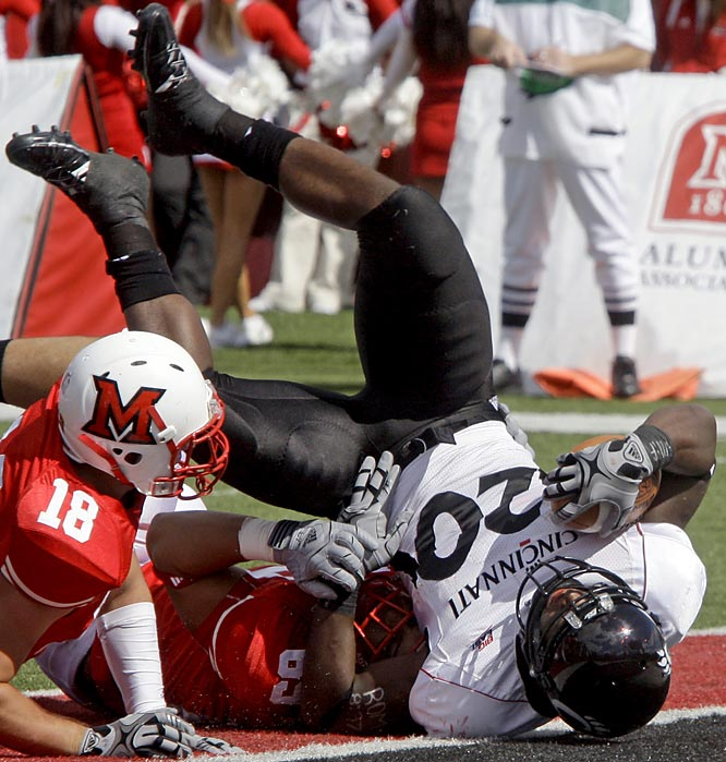 Jacob Ramsey ran for 103 yards and three touchdowns in Cincinnati's pass-oriented offense Saturday, and the Bearcats broke open a close game in the fourth quarter for a victory over Miami (Ohio).