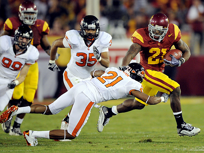 Allen Bradford gets into the Oregon State secondary. The junior rushed for a career-high 147 yards and two touchdowns, and 6-1 Southern California avenged its only loss of last season. Sean Canfield passed for 329 yards and three touchdowns for the 4-3 Beavers, who shredded USC's vaunted defense for 482 yards.