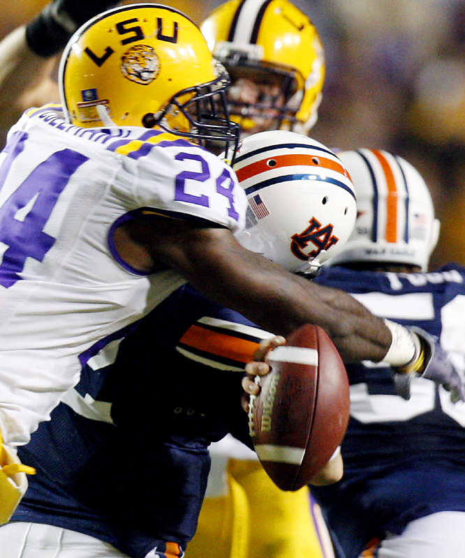 LSU linebacker Harry Coleman (24) causes quarterback Chris Todd to fumble during the first half. The Tigers defense held Todd to eight completions and 46 passing yards. Jordan Jefferson threw for a career-high 242 yards for LSU, which improved to 6-1.