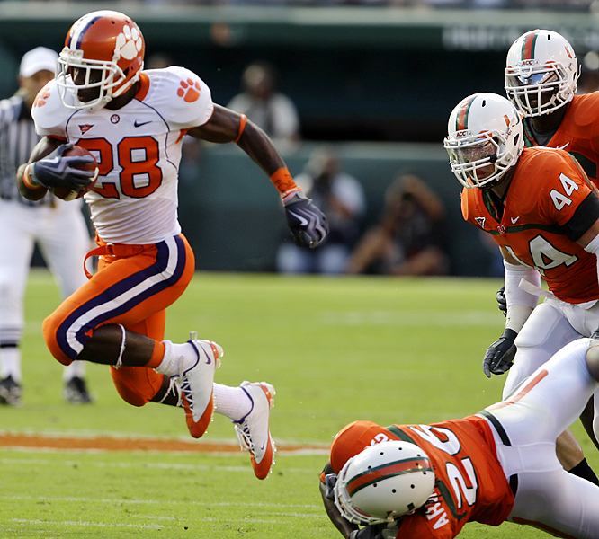 C.J. Spiller (left) caught six passes for 105 yards and a score, added 76 rushing yards on 14 carries, and ran a second-quarter kickoff back 90 yards for another score as Clemson prevailed in overtime. Kyle Parker's third scoring pass proved decisive for the 4-3 Tigers, who dealt Miami's (5-2) ACC title hopes a serious blow.