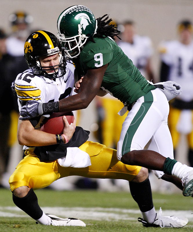 Michigan State's Jeremy Ware (right) sacks Iowa quarterback Ricky Stanzi during their Big Ten game in East Lansing, Mich. Stanzi connected with Marvin McNutt for a 7-yard touchdown pass as time expired as Iowa improved to 8-0 for the first time in school history.