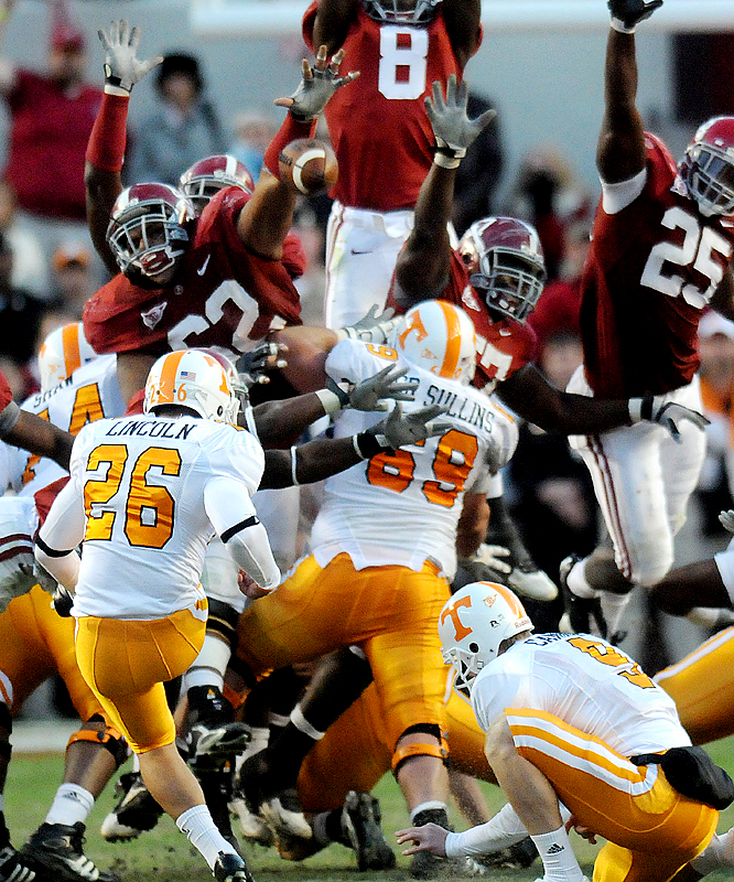 Alabama defensive lineman Terrence Cody (62) blocks a 44-yard field goal by Tennessee kicker Daniel Lincoln on the game's final play. Cody also blocked a 43-yard field goal earlier in the quarter.  The Tide's Mark Ingram rushed for 99 yards, but was kept out of the end zone for the first time this season. Leigh Tiffin's four field goals accounted for Alabama's scoring.