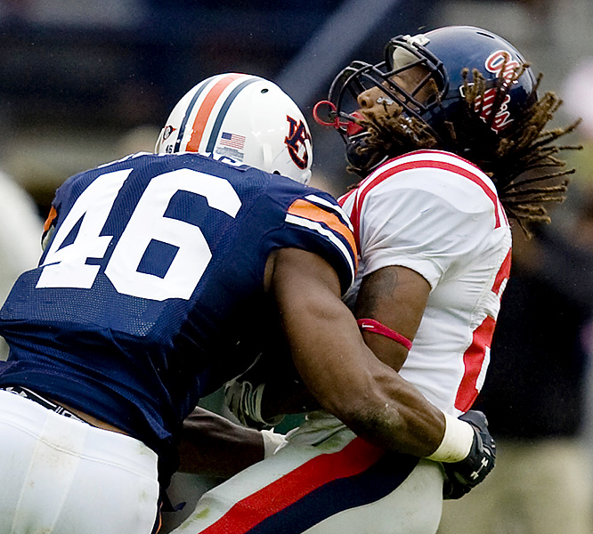 Auburn's Craig Stevens stops Ole Miss' Dexter McCluster in his tracks. The Tigers used big plays (Walter McFadden's interception return for a TD, Ben Tate's 53-yard scoring run and Demond Washington's return of a blocked extra point) to upend the Rebels and break their three-game losing streak.