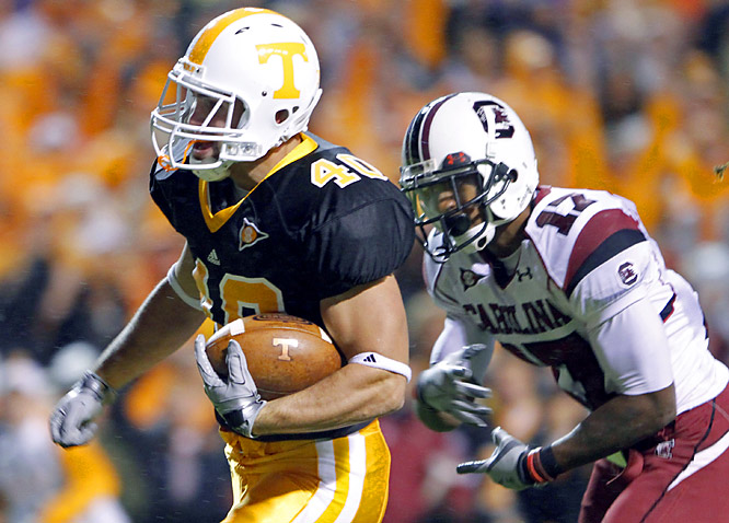Decked out in black jerseys, Tennessee took three South Carolina fumbles and turned them into touchdowns as coach Lane Kiffin grabbed his first win over a ranked opponent.