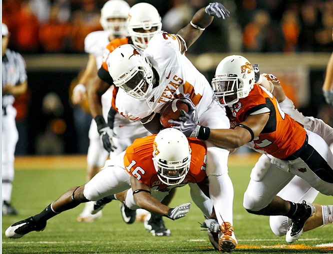 Curtis Brown and Earl Thomas each returned interceptions for touchdowns, and Cody Johnson (left) had two short TD runs as the Longhorns established themselves as the clear frontrunner in the Big 12 South.