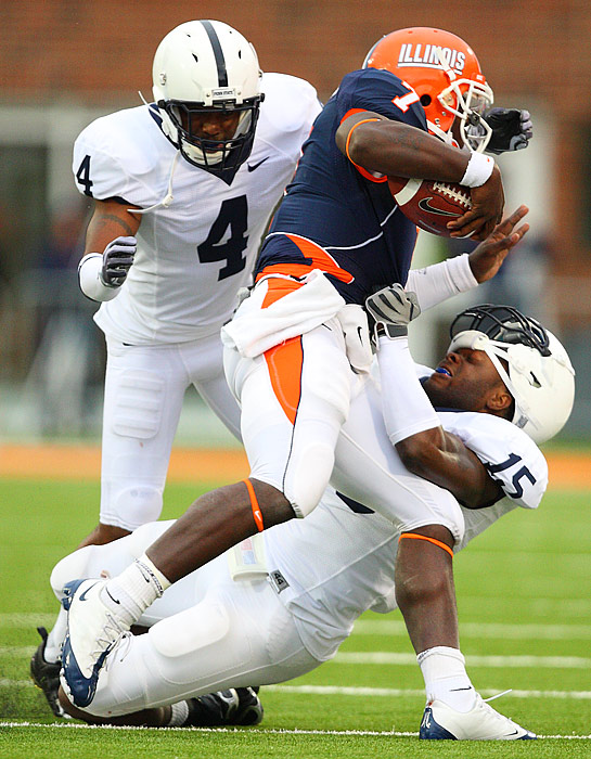 Linebacker Bani Gbadyu of Penn State gets his chinstrap tested during a takedown of Juice Williams of Illinois. Knowledge Timmons assisted on the play.