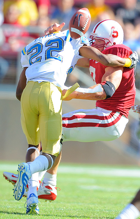 UCLA's Sheldon Price tackles Toby Gerhart, but that didn't stop the Cardinal from registering its first win in the rivalry since 2003.