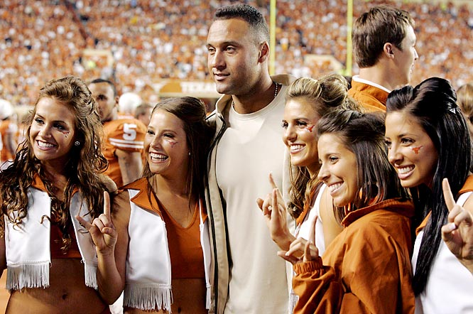 Jeter poses with a group of Texas cheerleaders during a 2008 game between the Longhorns and the Missouri Tigers at Darrell K Royal-Texas Memorial Stadium in Austin.
