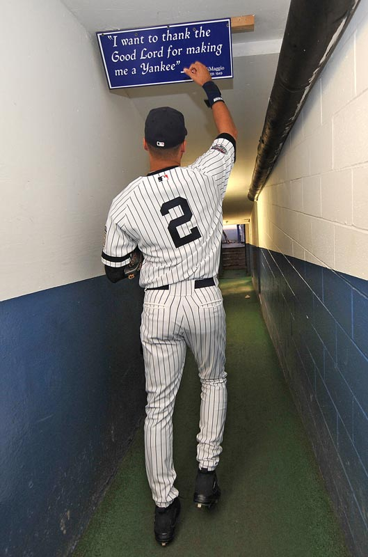 "Jeter walks down the hallway that leads away from the clubhouse and touches a sign with the famous Joe DiMaggio quote, ""I want to thank the Good Lord for making me a Yankee."""