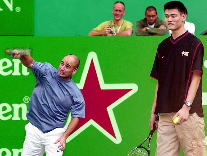 Andre Agassi and Yao Ming participate in a charity event during the Heineken Open Shanghai Tournament.