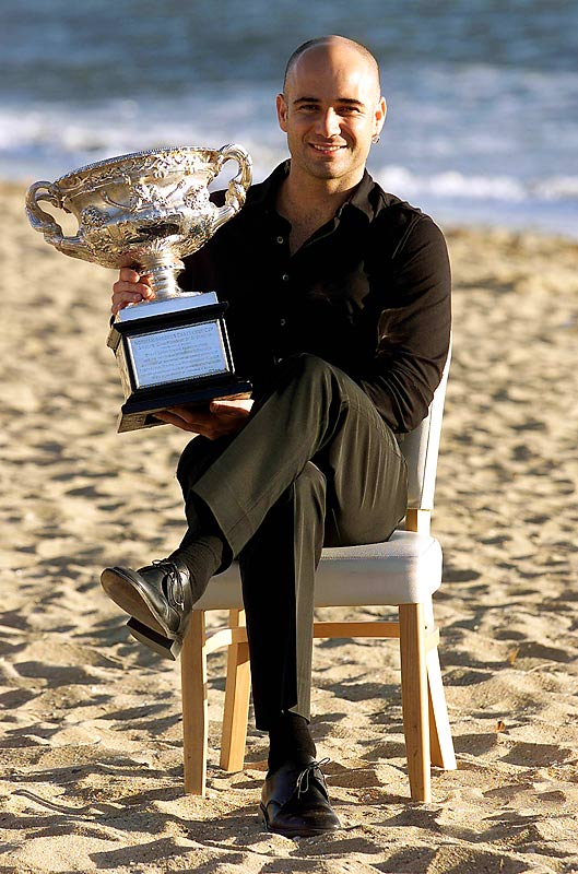 Andre Agassi poses with his Australian Open trophy on St. Kilda Beach in Melbourne.