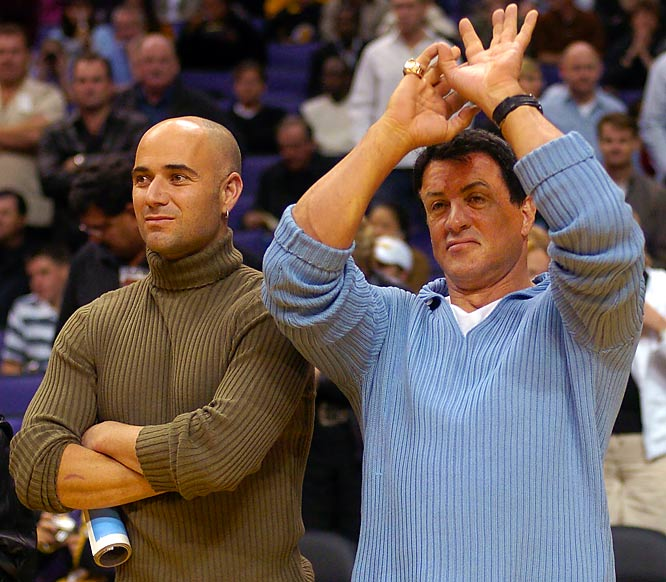 Sylvester Stallone does his Kobe Bryant imitation as Andre Agassi looks on prior to the Lakers first-round  playoff game against the Rockets.