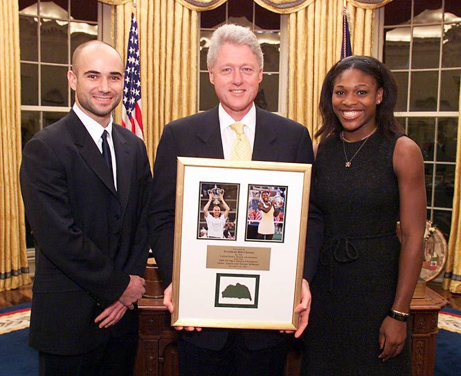 President Clinton poses with 1999 U.S. Open champions Andre Agassi and Serena Williams in the Oval Office.
