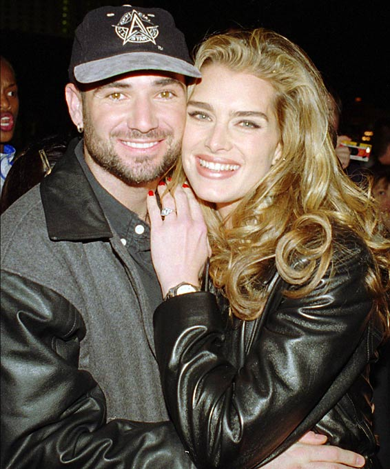 Andre Agassi hugs his then-fiancee Brook Shields as they arrive for the grand opening of the Official All-Star Cafe in Las Vegas.