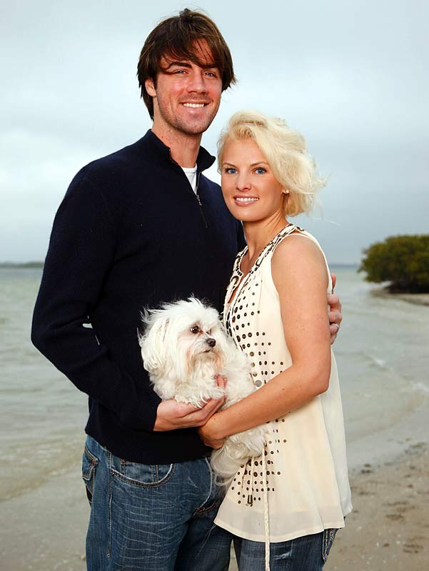 Cole Hamels and his wife, Heidi Strobel, pose on a beach in Clearwater, Fla., with a four-legged friend.