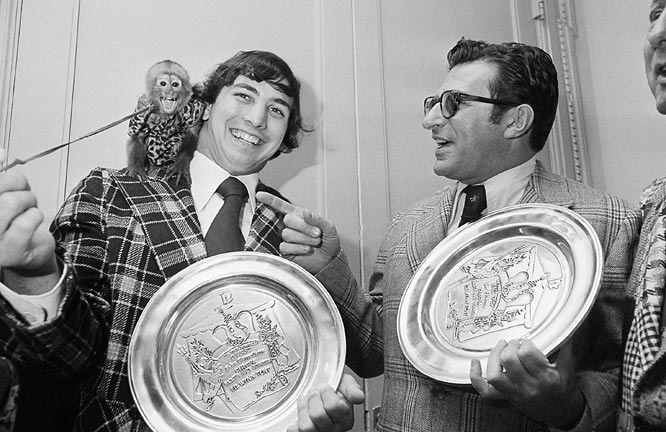 Heisman trophy winner John Cappelletti and Paterno have fun with an organ grinders monkey after they were awarded trophies at a Saints and Sinners luncheon.