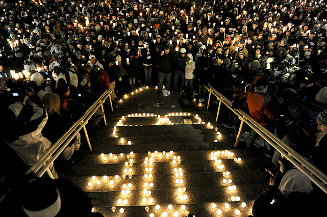 Penn State students hold a candlelight vigil in remembrance of Paterno.
