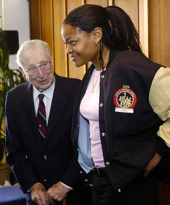 Former Duke star Alana Beard talks with  Wooden after winning the first women's Wooden Award.