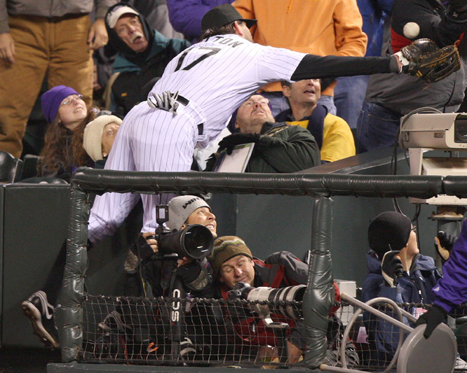 Todd Helton of the Colorado Rockies fails to reach a foul ball against the Philadelphia Phillies in Game 3 of the NLDS playoffs at Coors Field in Denver.