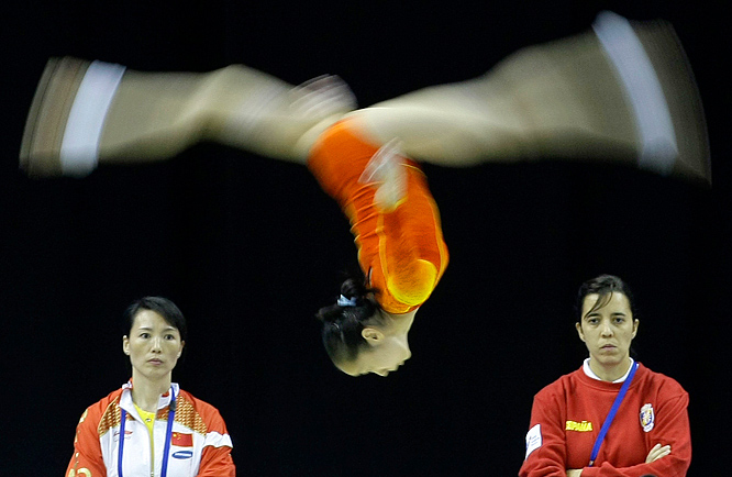 China's Deng Lin Lin performs on the beam during a training session at the World Gymnastics championships in London.