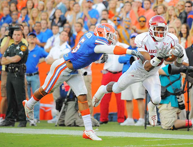 Arkansas wideout Greg Childs lunges past Florida cornerback Joe Haden but didn't hold on to the pass, which would have given the Razorbacks a first-and-goal in the third quarter. TheGators edged Arkansas 23-20 in the Swamp onCaleb Sturgis's 27-yard field goal with nine secondsleft. Florida was No. 1 in the first BCS rankings, released on Sunday.