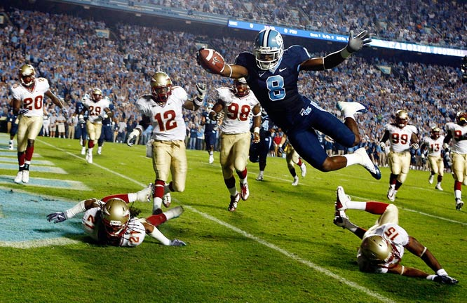 Greg Little of North Carolina dives past Florida State defenders Patrick Robinson and Ochuko Jenije during the Tar Heels' 30-27 loss.